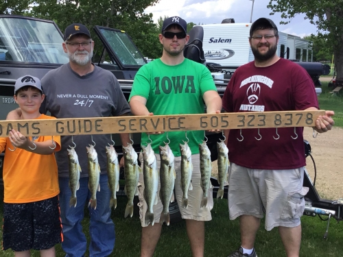 Guided fishing trip with Adams Guide Service, multiple generations.