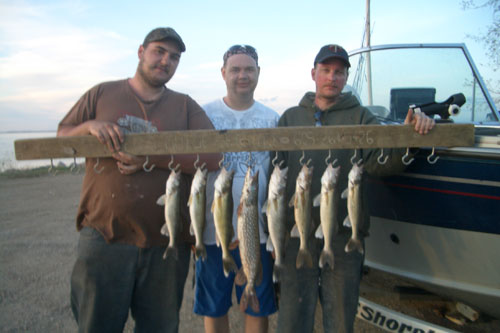 Some buddies posing with our catch of the day
