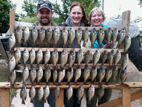 Travis, Lori and Kia showing off their catch of the day